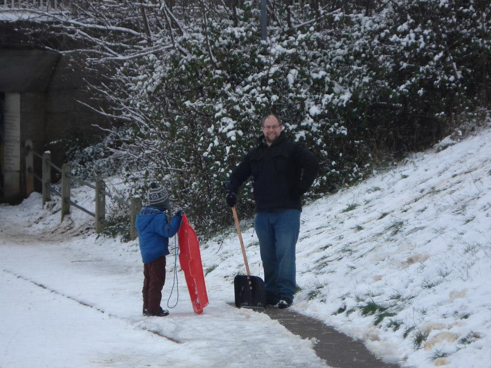 Jon Wade and son clearing a path in Great Baddow